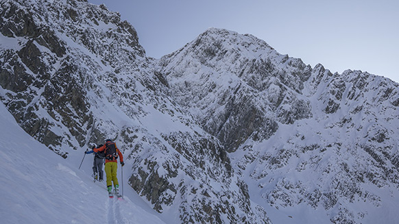 Couloir skiing at sunset